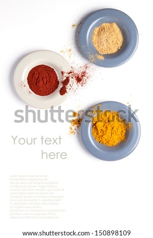Top view on plates with mix of spices isolated with sample text - stock photo