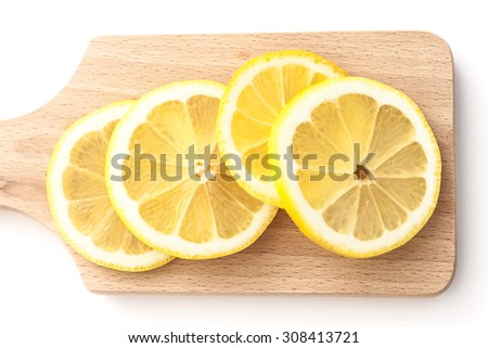 Top view on sliced lemons on a cutting board - stock photo