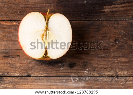 top view on sweet half apple on old wooden table - stock photo
