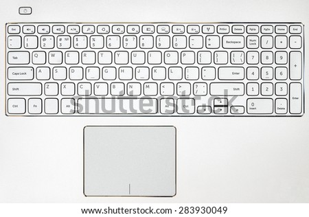 Top view on the gray laptop keyboard - stock photo