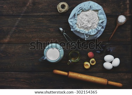 Top view on the table are the products to the test, or flaky biscuit, fruit for the filling - stock photo