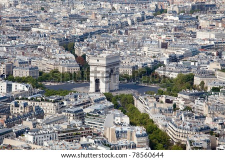Top view on Triumphal Arch and Etoile square, roofs, housetops, city residential quarters and downtown, center streets in Paris France - stock photo