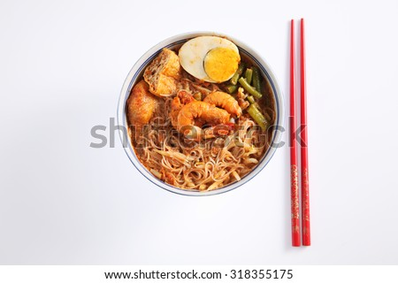top view oof prawn curry vermicelli on the white background - stock photo