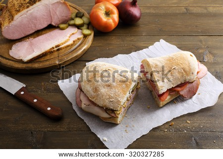 top view Pastrami sandwich on rustic table - stock photo