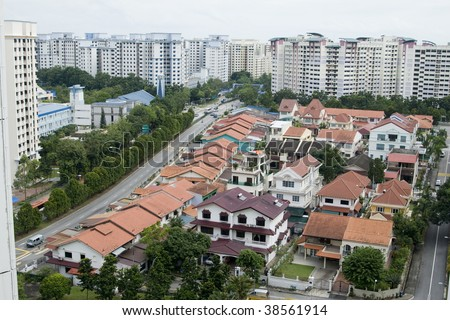 Top view photo shot of some landed property houses and some goverment apartments in the background. - stock photo