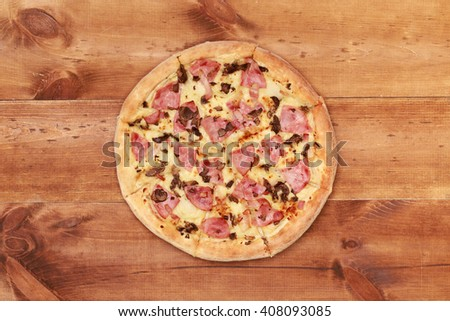 Top view pizza on wooden table. Tasty delicious pizza on the old boards. Table with pizza  cooking. Fast food. Traditional food. delicious italian pizza served on wooden table above view - stock photo
