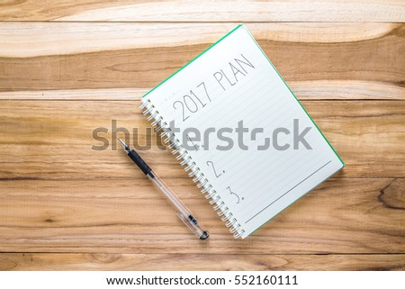 Top view 2017 plan list with notebook on wooden desk