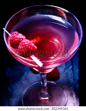 Top view pomegranate drink with raspberries on black background.  - stock photo