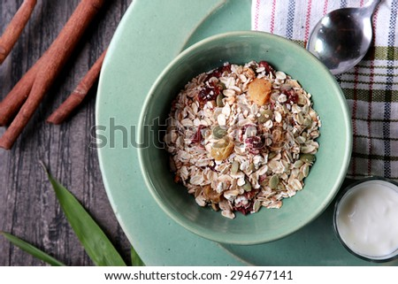 top view portrait of a bowl of muesli served with yoghurt - stock photo