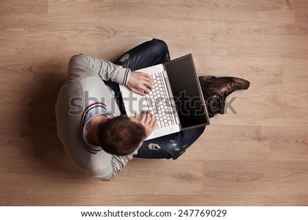 top view portrait of young man with laptop