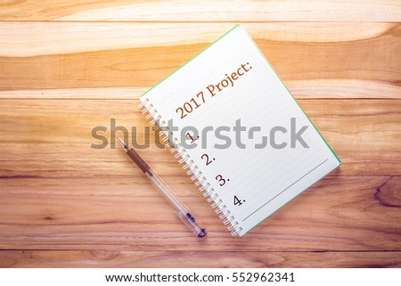 Top view 2017 Project list with notebook on wooden desk