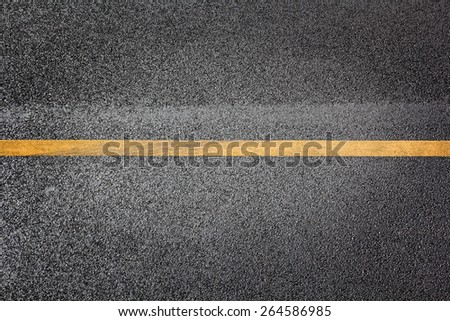 top view road highway surface with single yellow line asphalt backdrop vignette - stock photo