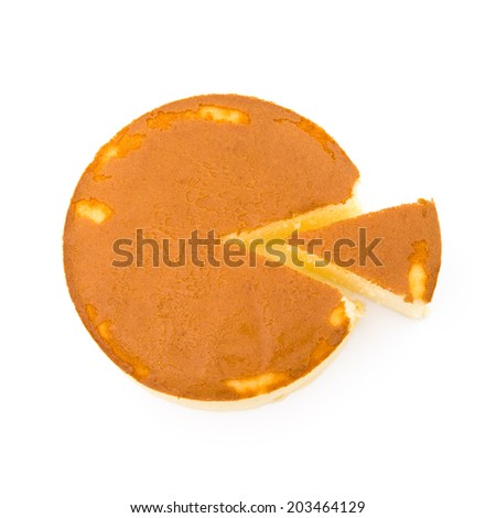 top view round cheese cake with one piece cut out on white - stock photo
