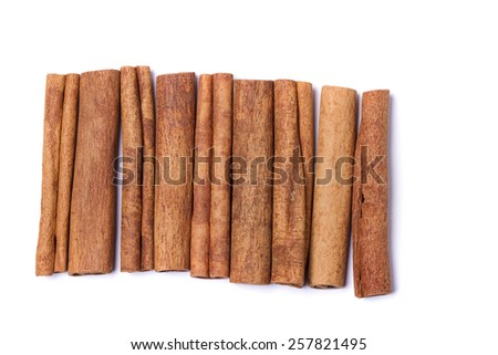 Top view row of aromatic cinnamon sticks.