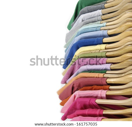 Top view Set of Choice of man clothes of different colors on wooden hangers  - stock photo