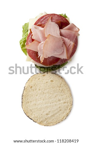 Top view shot of a yummy ham and salami sandwich - stock photo