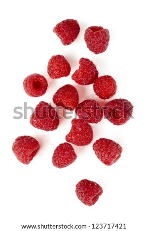 Top view shot of juicy raspberries scattered in a white background - stock photo