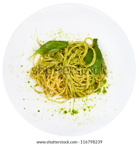top view spaghetti mixed with pesto on plate isolated on white background - stock photo