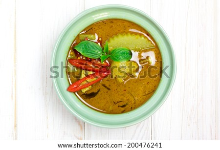 Top view, Spicy chicken green curry on wood - stock photo