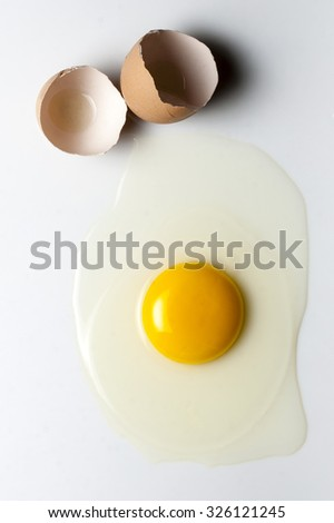 Top view splattered broken egg and egg shell - stock photo