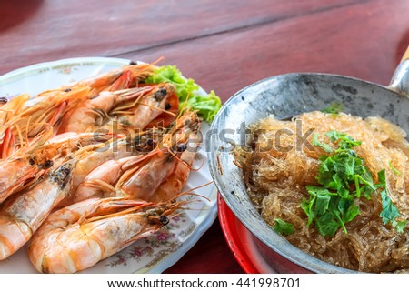 Top view steamed shrimp/prawn in the white plate and shrimps vermicelli  with glass noodles in hot pot ready to eat - stock photo