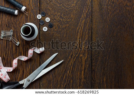 Top view tailor items on wooden background with copy space.