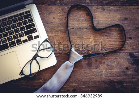 """top view tie make like """"love"""" """"heart"""" """"i love my job""""  with laptop and lens on old wood vintage  - stock photo"""