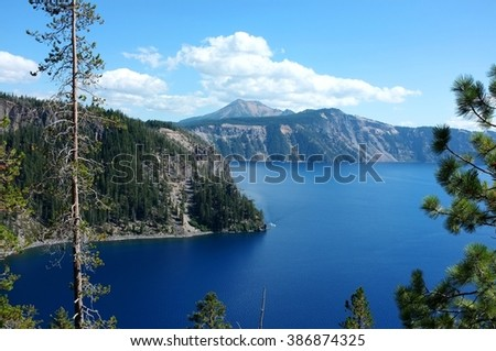Top view to Crater Lake, Oregon, USA. Landscape with forest mountain ridge and water surface. - stock photo