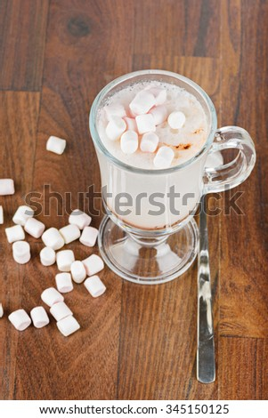 Top view to the hot chocolate with marshmallows against a wooden background - stock photo