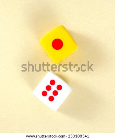 Top view two disc show number 1 and 6 on yellow background. - stock photo