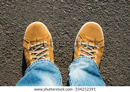 top view were suede yellow boots - stock photo