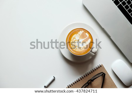 top view with copy space Office white desk table with computer, supplies, coffee cup. - stock photo
