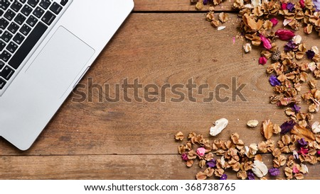 Top view workspace with blank notebook,pen and dried flowers on wooden table background . - stock photo