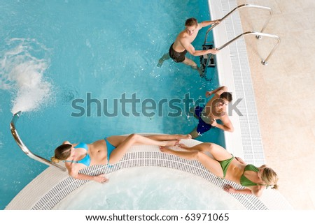 Top view - young people relax in swimming pool at bubble bath - stock photo