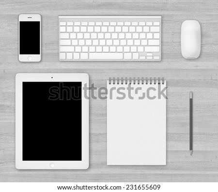Top white wood office table with note, pencil, tablet, mouse, smartphone and keyboard - stock photo