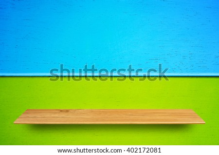 Top wooden shelves and wooden wall background - For product display.