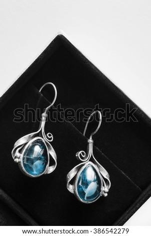 Topaz vintage earrings in black jewel box closeup - stock photo