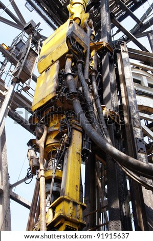 Topdrive attached to the dolly track for Oil Drilling Rig - stock photo