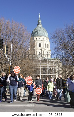 TOPEKA, KS - JAN 22: Public demonstration in favor of the pro-life movement and against abortion at the capital building in Topeka, KS on Jan. 22, 2009.