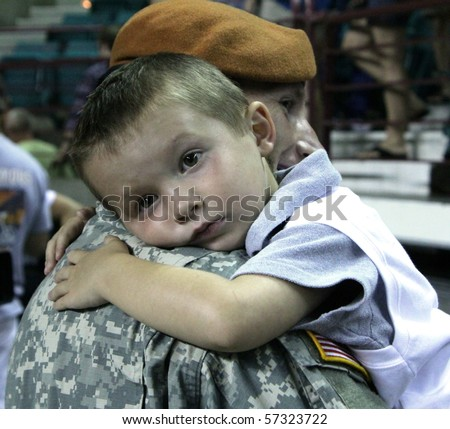 TOPEKA, KS - JULY 17: A young boy hugs his father, a Kansas National Guard soldier who just returned from deployment to Egypt July 17, 2010 in Topeka, KS.