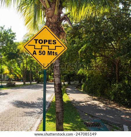 Topes speed bump sign at caribbean street, Playa del Carmen, Mexico  - stock photo