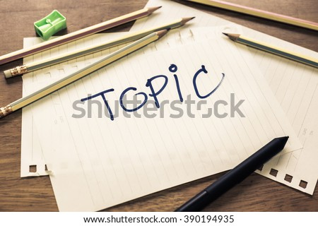 Topic text handwriting on papers with many pencils - stock photo