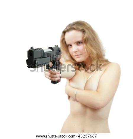 Topless blonde girl aiming a black gun. Focus on gun only - stock photo