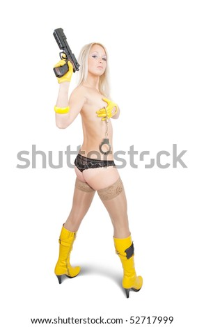 Topless blonde girl with gun and manacles over white - stock photo