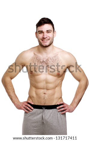 Topless man stood with his hands on his hips isolated on a white background