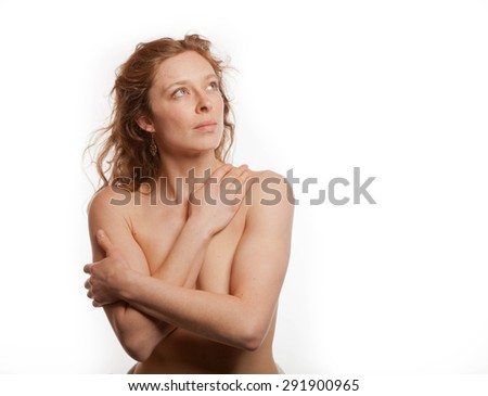 Topless redhead with blue eyes isolated on a white background looking up and to camera right