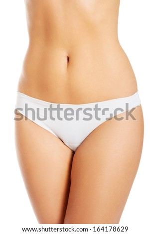 Topless woman in panties showin her flat belly. Isolated on white.  - stock photo