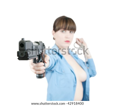 Topless woman in uniform with gun and manacles over white, Focus on gun only - stock photo