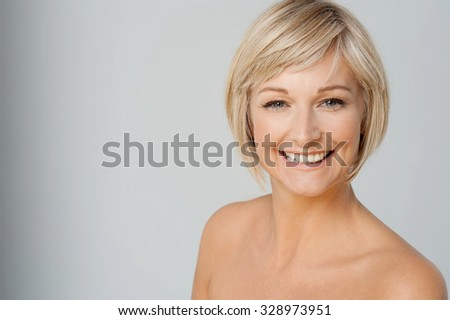 Topless woman posing over grey background - stock photo
