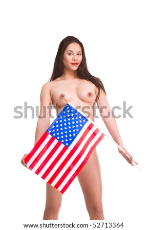 Topless young Asian woman standing holding American flag in front of her - stock photo